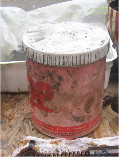 image of dirty can of brake caliper red rubber grease